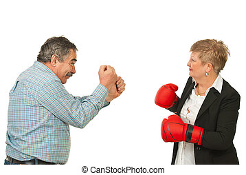 Mature business people having confrontation - Two mature...