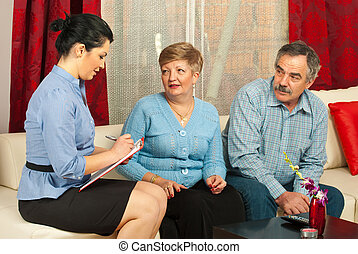Financial consultant with mature couple - Financial...