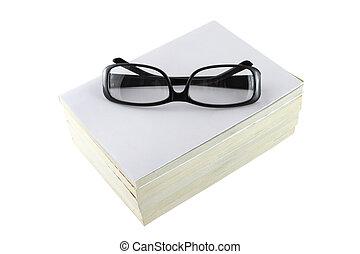 Black eye glasses frame on white book.