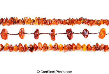 Beads of amber laid in a row