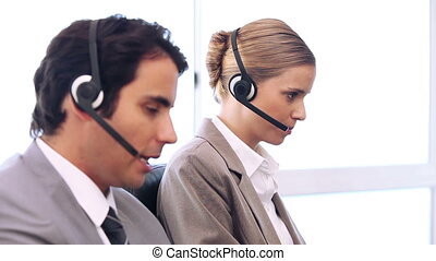 Call centre agents working in their office - Call centre...