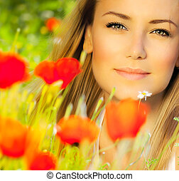 Closeup on beautiful woman face, female enjoying flower...