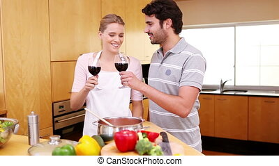 Young couple celebrating with wine