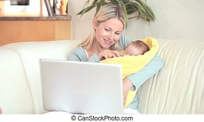 Woman holding a child is making a video call