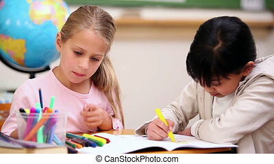 Classmates coloring in the classroom