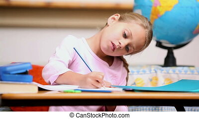 Pupil writing on a notebook