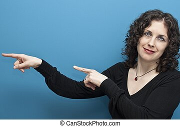 Woman pointing at something interes - WOMAN ON A BLUE...