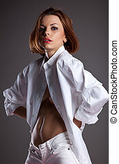 Desired young woman in white shirt undress jeans - Beauty...