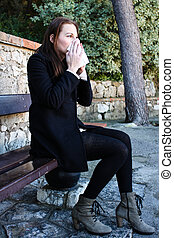Attractive Brunette Woman Blowing Her Nose While Sitting On...