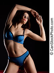 Beauty woman with perfect body in blue lingerie