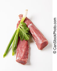 Raw pork tenderloin and spring onion - studio