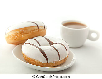 Donuts with cup of coffee on the white background