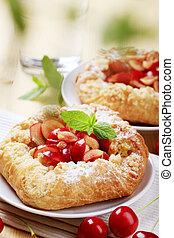 Danish pastry with fresh cherries - closeup
