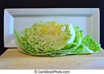 iceberg lettuce cut in half - Head of iceberg lettuce cut in...