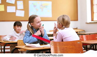 Classmates talking together in the classroom