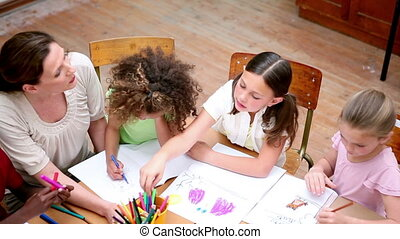 Pupils drawing with coloring pens