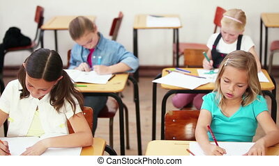 Young girls doing exercises in the classroom