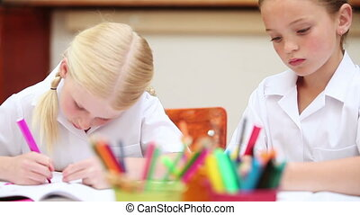 Girls drawing - Girls attentively drawing in the classroom