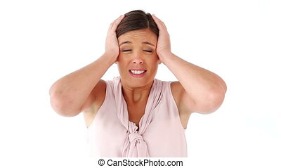 Woman showing her headache against a white background