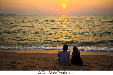 Interracial lover on the beach at sunset