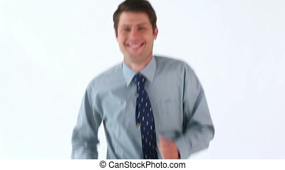 Smiling man jogging against a white background