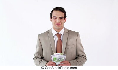 Happy businessman throwing bank notes against a white...