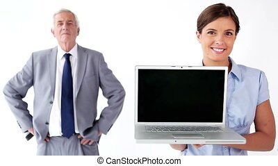 Smiling employee holding a laptop against a white background