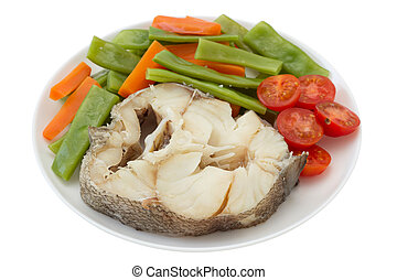 boiled fish with vegetables on the plate