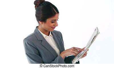 Businesswoman reading a newspaper against a white background