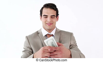 Smiling man holding a fan of dollar notes