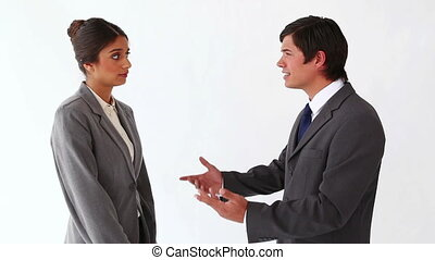 Businessman talking to her secretary against a white...