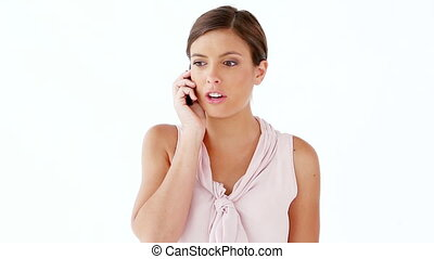 Smiling woman using a cellphone against a white background