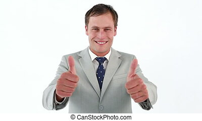 Businessman placing his thumbs up