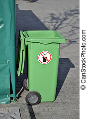 green waste bin with wheels standing on the street