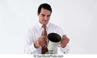 Smiling man holding his cup against a white background
