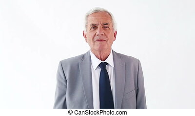 Serious man pointing his finger against a white background