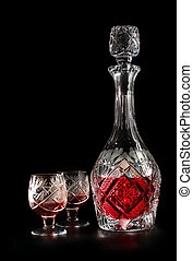 Crystal decanter of liquor on a black background Isolated...