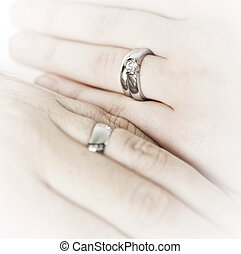 Hands wearing wedding rings - Closeup on hands of married...