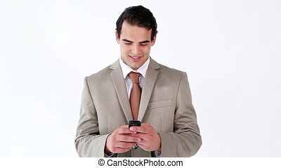 Smiling man sending a text with his cellphone