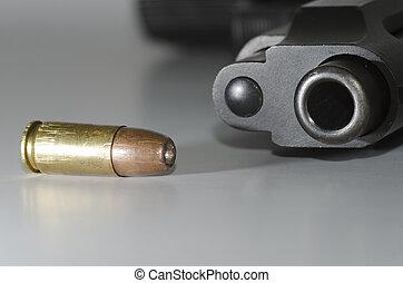 bullet and gun barrel - closeup of a bullet and gun barrel
