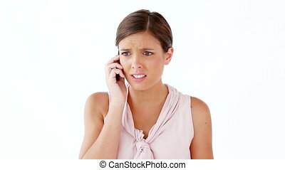 Worried woman using her cellphone