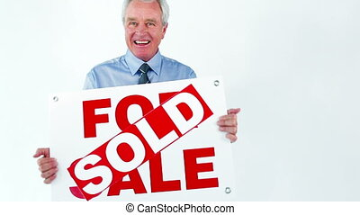 Happy man holding a board against a white background