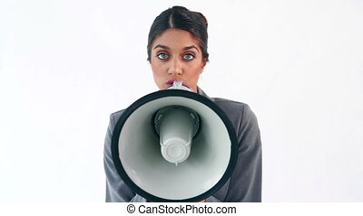 Businesswoman using a megaphone against a white background
