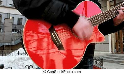 red guitar - street musician