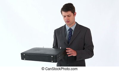 Happy man opening his briefcase against a white background
