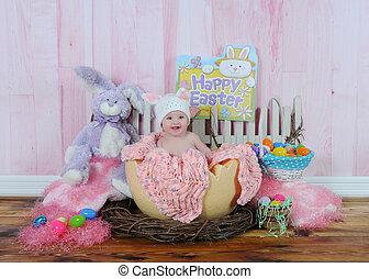 sweet baby girl in easter egg