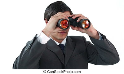 Executive looking through binoculars against a white...