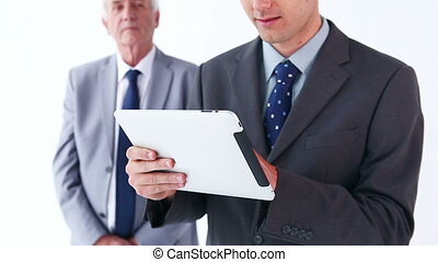 Executive using a tablet computer against a white background