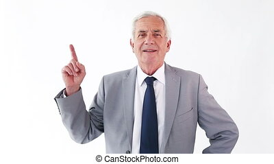 Smiling mature man pointing his finger up