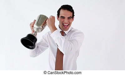 Happy executive holding a cup against a white background